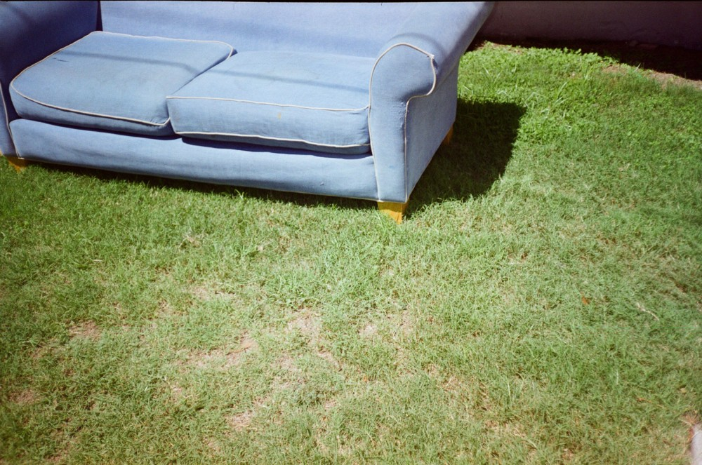 Photograph of a couch on a lawn. By Brenda Cruz Wolf